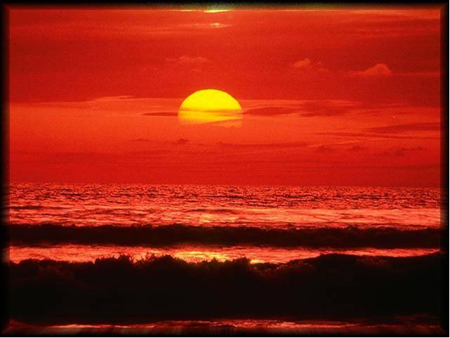 sunset over an ocean waves